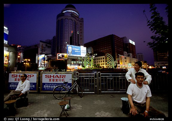 Public massage on the traffic square at  the intersection of Zhengyi Lu and Dongfeng Lu. Kunming, Yunnan, China (color)