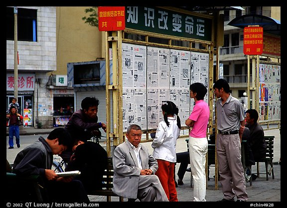 Reading dazibao (public newspapers). Kunming, Yunnan, China (color)