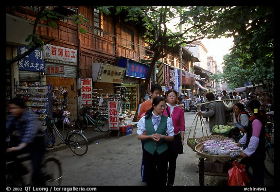 Street vendors in an old street. Kunming, Yunnan, China (color)