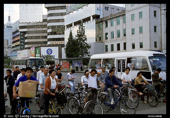 Bicyclists waiting for traffic light. Kunming, Yunnan, China (color)