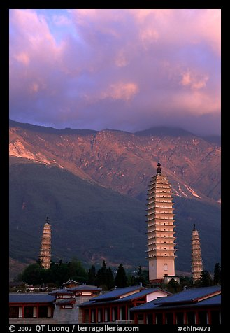 San Ta Si (Three pagodas) at sunrise with Cang Shan mountains in the background. Dali, Yunnan, China (color)