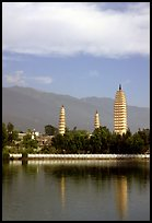 San Ta Si (Three pagodas) reflected in a lake, early morning. Dali, Yunnan, China (color)