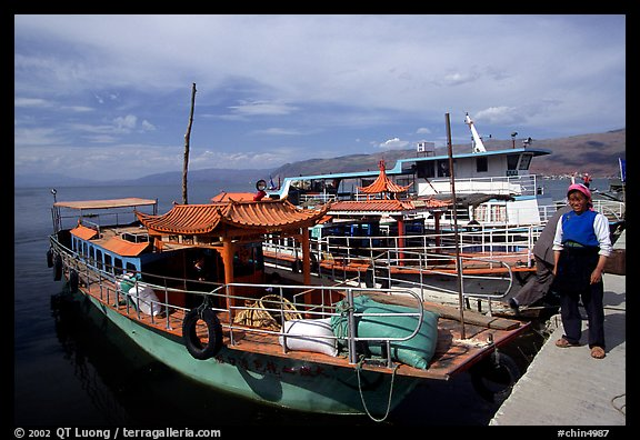 Boats on a pier of Erhai Lake. Dali, Yunnan, China
