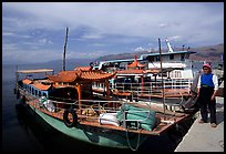 Boats on a pier of Erhai Lake. Dali, Yunnan, China (color)