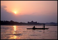 Fishermen at the confluence of the Dadu He and Min He rivers at sunset. Leshan, Sichuan, China
