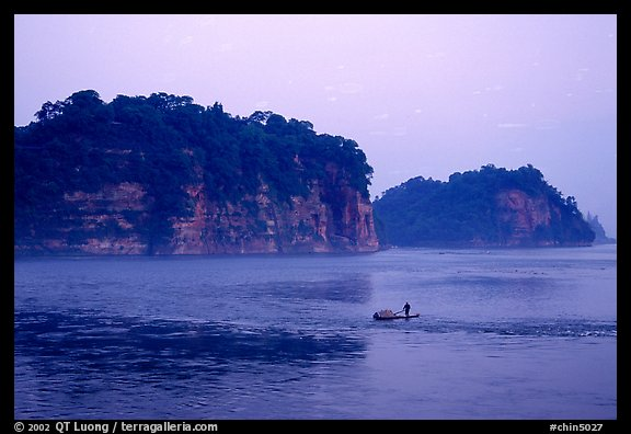 Cliffs of Lingyun Hill and Wuyou Hill at dusk, whose shape evokes a lying buddha. Leshan, Sichuan, China (color)