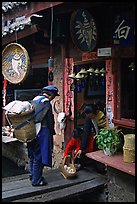 Naxi woman offers eggs for sale to local residents. Lijiang, Yunnan, China ( color)
