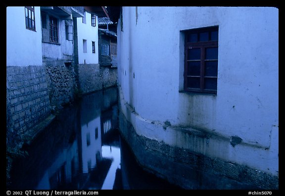 White walled houses surrounding a canal. Lijiang, Yunnan, China (color)