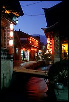 Streets, bridge, wooden houses, red lanterns and canal. Lijiang, Yunnan, China