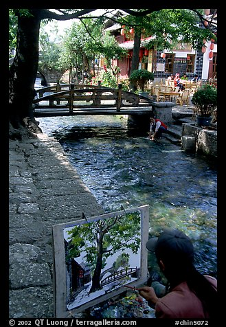 Painting a bridge. Lijiang, Yunnan, China (color)