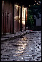Cobblestone street and wooden doors at sunrise. Lijiang, Yunnan, China ( color)