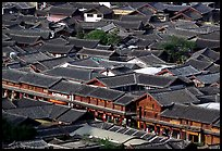 Rooftops of the old town seen from Wangu tower. Lijiang, Yunnan, China (color)