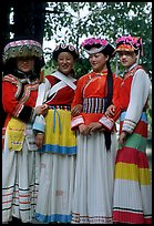 Women wearing Naxi dress. Lijiang, Yunnan, China