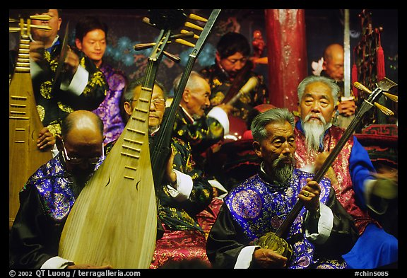 Elderly musicians of the Naxi Orchestra playing traditional instruments. Lijiang, Yunnan, China