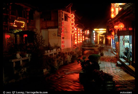 Red lanterns reflected in a canal at night. Lijiang, Yunnan, China