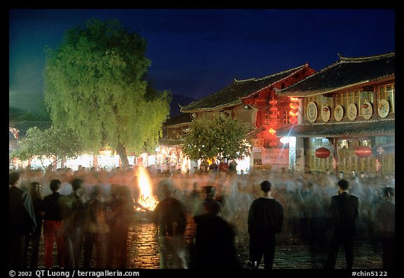 Celebration around a fire in Square Street by night. Lijiang, Yunnan, China