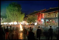 Celebration around a fire in Square Street by night. Lijiang, Yunnan, China ( color)