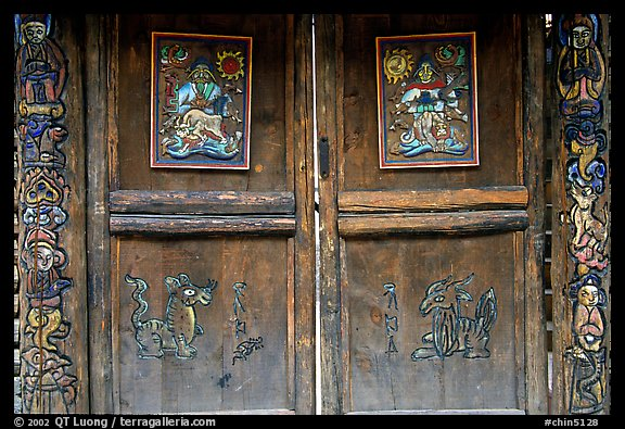 Decorated doors of a temple. Lijiang, Yunnan, China