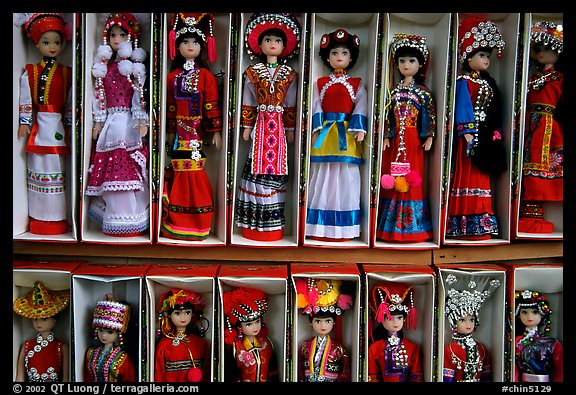 Dolls wearing traditional Bai dress. Lijiang, Yunnan, China