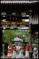 Women in Naxi dress standing in an archway. Lijiang, Yunnan, China ( color)