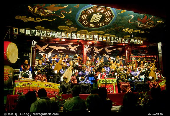 Naxi orchestra in Dayan Naxi concert hall. Lijiang, Yunnan, China (color)