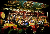 Naxi orchestra in Dayan Naxi concert hall. Lijiang, Yunnan, China ( color)