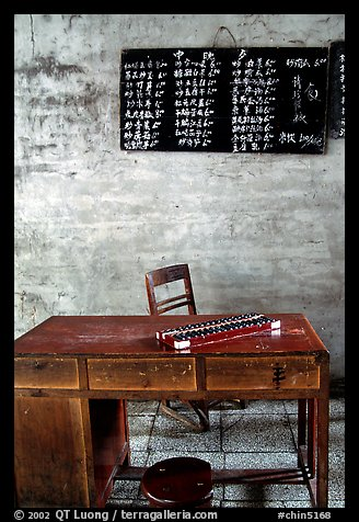 Desk counting frame and Chinese script on blackboard. Emei Shan, Sichuan, China (color)