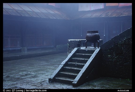 Urn and stairs in courtyard of Xiangfeng temple in fog. Emei Shan, Sichuan, China (color)