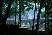 Bailongdong temple seen through trees. Emei Shan, Sichuan, China ( color)