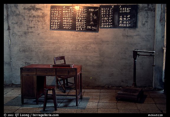 Desk with counting frame, blackboard with Chinese script, scale. Emei Shan, Sichuan, China (color)