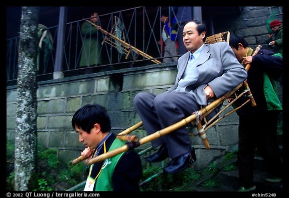 Wealthy pilgrim carried down Jieyin Palace on a chair. Emei Shan, Sichuan, China (color)