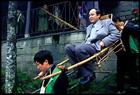 Wealthy pilgrim carried down Jieyin Palace on a chair. Emei Shan, Sichuan, China ( color)
