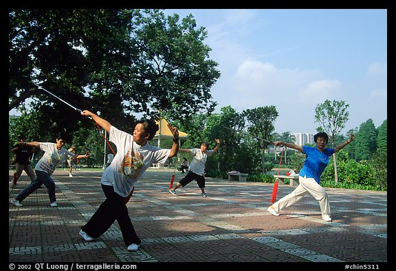 Collective exercise gymnastics with swords,  Liuha Park. Guangzhou, Guangdong, China (color)