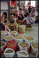 Woman selling dried food items inside the Qingping market. Guangzhou, Guangdong, China ( color)
