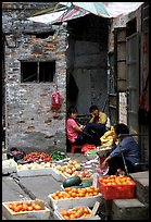 Fruit vendors in a narrow alley. Guangzhou, Guangdong, China