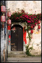 Wooden door with lanterns and flowers. Hongcun Village, Anhui, China ( color)