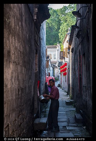 Man using stream water in alley. Hongcun Village, Anhui, China (color)