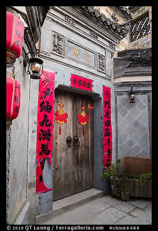 Door with red caligraphed banners. Hongcun Village, Anhui, China (color)