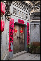 Door with red caligraphed banners. Hongcun Village, Anhui, China ( color)