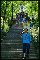 Sedan chair carriers on steep staircase. Huangshan Mountain, China ( color)