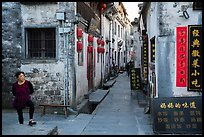 Woman standing next to main street. Xidi Village, Anhui, China ( color)