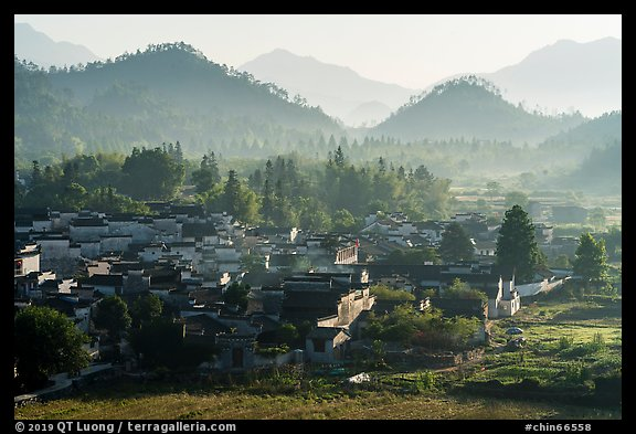 Village and hills in morning fog. Xidi Village, Anhui, China (color)
