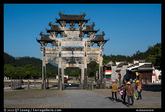 Villagers heading towrds fields, and Hu Wenguang Memorial Arch. Xidi Village, Anhui, China (color)
