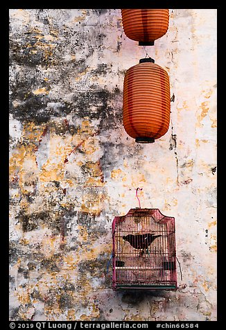 Caged bird and lanterns. Xidi Village, Anhui, China (color)