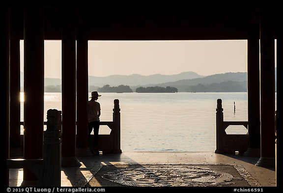 Man in Cuiguang Pavilion and West Lake. Hangzhou, China (color)