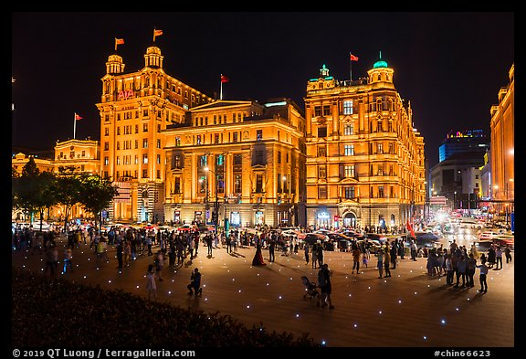 Colonial-area buildings illuminated at night, the Bund. Shanghai, China (color)