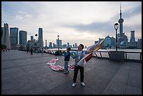 Men preparing to fly kites. Shanghai, China ( color)