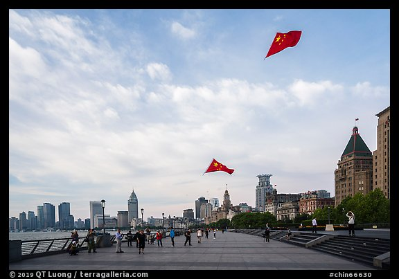 Chinese flats on kite lines, the Bund. Shanghai, China (color)