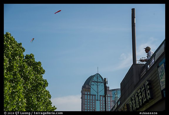 Man flying kite, the Bund. Shanghai, China (color)