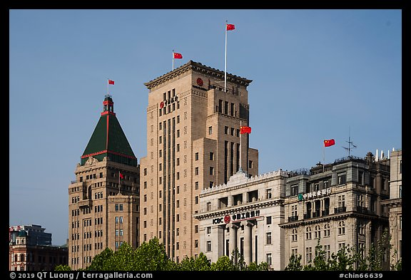 Colonial area buildings with Chinese flags. Shanghai, China (color)